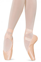 The Amelie features a medium shank and is an introductory pointe shoe, designed for dancers new to pointe work.  Features  The graded shank allows the foot to roll up onto pointe with ease and emphasizes the line of the instep while the angled platform stabilizes the foot. The gently curved sides of the box encourage the foot into correct alignment when 'en pointe' and the shallow box encases and supports the toes laterally and the elastic drawstring draws the shoe around foot. The combination of these features makes the Amelie styles suitable for a variety of foot shapes especially for the beginner or elementary level dancer who requires a flexible shoe. Notes  Ribbons and elastic sold separately