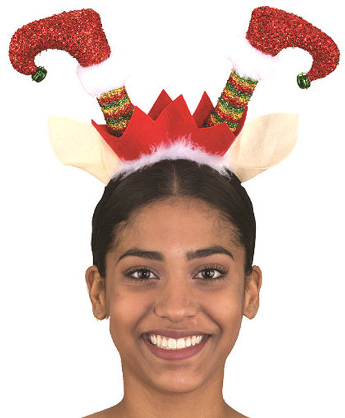 """Celebrate Christmas with this adorable and funny headband. Topped with adorable elf legs that have working bells on their toes. Perfect for office celebrations, parades, theater, and more. One size fits most. Elf legs are about 7"""" tall."""