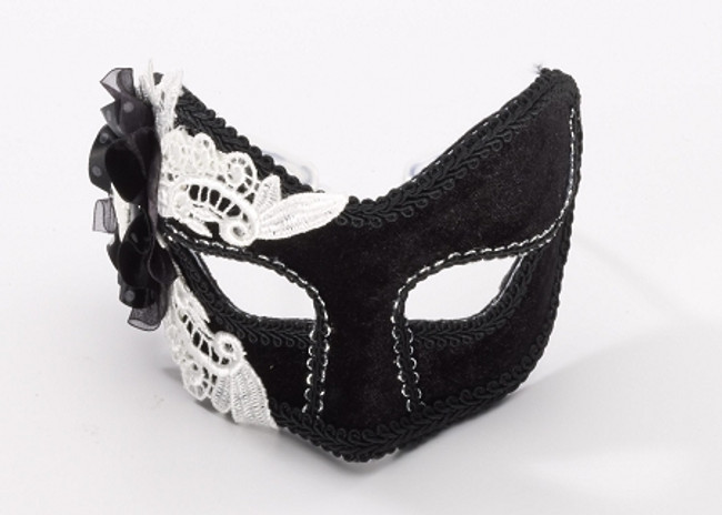 /black-venetian-mask-with-skeleton-broch-on-the-side/