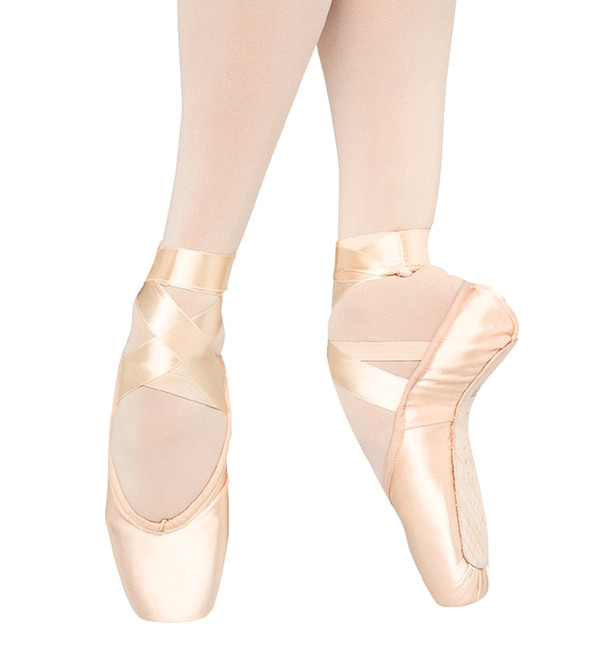 Aspiration pointe shoe provides stability and support with a wide box and strong shank.  Features  The Aspiration is designed for the advanced student dancer with highly flexible insteps and ankles. It is designed to give the dancer when 'en pointe' the feeling of being elevated up out of the shoe and held away from the floor. The shank has an extra board shortened under the metatarsal which provides stability and support however this extra strength in the shank does not extend to the heel. This allows the foot to arch at the ¾ point with the heel being able to bend away from the foot. The platform is both high and wide to allow maximum balance when 'en pointe'. Notes  Ribbons and elastic sold separately