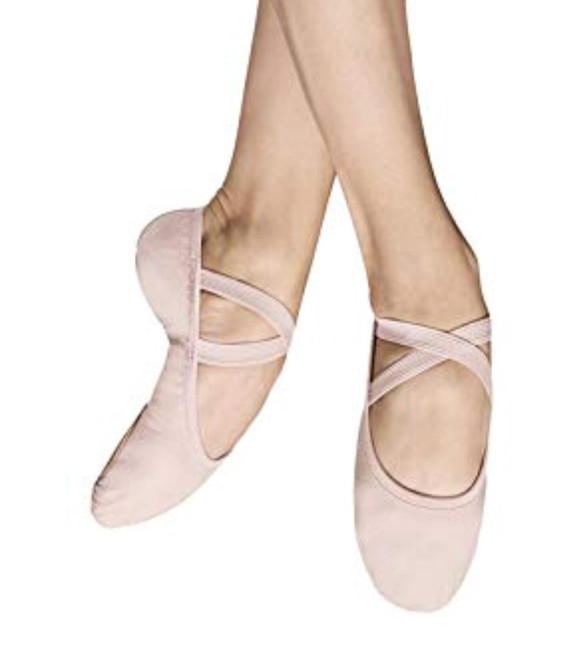 A Bloch Favorite! Super soft and lightweight ballet flat hugs the dancer's foot perfectly  Features  A super comfortable lightweight stretch canvas split sole The toe shape is specifically designed for ultimate balance Adheres to the arch beautifully Shock absorbing heel cushioning Pre-sewn crossed elastics Generous front and rear leather sole pads Fabric  Super soft stretch canvas; Suede foot pads Sizing Information & Suggestions  Start with 2 sizes down from street shoe Width Suggestions: B - Narrow C - Medium D - Wide