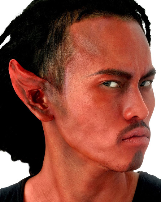The Woochie Devil Ears are a pair of red pointed ear tips that fit over the top of your own ears. Made of pre-colored light weight latex, these ears are perfect to give a devlish flare to any costume. Spirit gum, flesh latex, and makeup sold separately.
