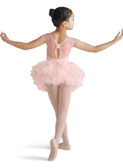 Your budding ballerina will love this adorable tutu dress, an all in one piece that is especially ideal for younger dancers as it can be pulled on easily over a pair of ballet tights. Mesh cap sleeves continue into an embroidered mesh bow back design with a small keyhole at the center of the back. A modest scoop front neckline provides full coverage for your tiny dancer. An attached tutu skirt is made up of graduating layers of soft tulle to give that bouncy and voluminous tutu look.  Features  Scoop front and bow back Embroidered mesh back Mesh cap sleeves Keyhole back Attached tutu skirt Front lining Ballet leg line Notes  Machine wash cold, lay flat to dry. Colors available: Pink and Melon