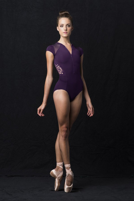 A leotard that is sure to stand out, this cap sleeve leotard features a high neck, zipper front that can be worn as desired. The cap sleeves are enhanced by the power mesh fabric inserted in the shoulders and wraps around to the back. Front princess seams and hip seams add shape and style to this beautiful garment. An embroidered cut out motif decorates the side bodice of this exceptional garment.  Features  High neck and back Zipper front Mesh panel shoulder inserts Cap sleeves Front princess seams and hip seams Embroidered cut out motif decorates side bodice Front lining High cut line Notes  Machine wash cold, lay flat to dry.