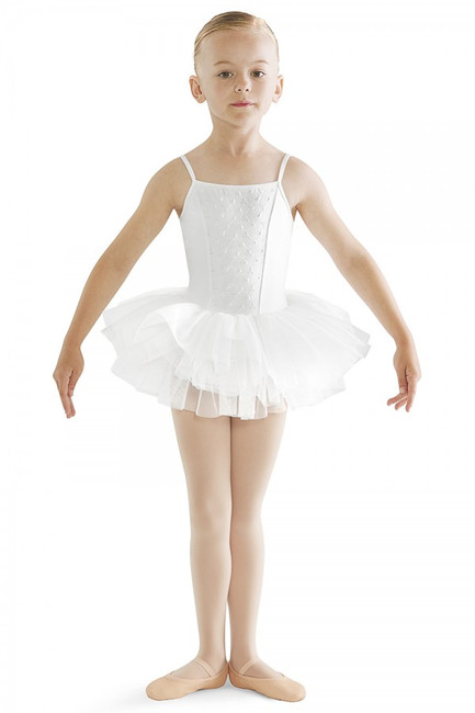 Dance on cloud nine in this dreamy camisole tutu dress. This adorable dress features an embroidery anglaise front panel for a sweet design. At the waist, an attached tutu skirt crafted with graduating layers of soft tulle, creating a full and voluminous traditional 'tutu look'. An all in one piece which is easy for a young dancer to wear comfortably over a pair of ballet tights.  Features  Straight front and back Embroidered anglaise front panel Camisole style Attached full tutu skirt Ballet leg line Full front lining Notes  Machine wash cold, lay flat to dry