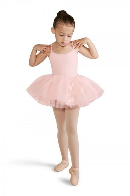 This tutu cute tutu skirt celebrates the essence of spring! The top layer features an adorable floral applique. The elasticated waistband can be pulled on easily over a leotard and pair of tights, designed with graduating layers of soft tulle creating a voluminous traditional 'tutu look'.  Features  Floral applique design Pull on styling Three graduating layers of soft tulle Elasticated waistband Leotard sold separately Notes  Machine wash cold, lay flat to dry