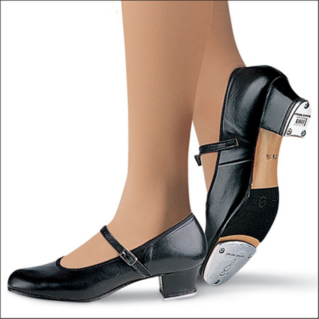 """Practical all leather tap shoe for class, rehearsal, or performance.  Features  Non-slip pro balance rubber pad behind the forefoot tap, with channels to allow flexibility Soft cotton and leather lining for comfort Padded insole for shock absorption Strap and buckle attached with elastic for comfort and flexibility Sturdy 1 1/2"""" heel for serious tappers who want strength with style Fabric  Leather Sizing Information & Suggestions  Start with 1 full size up from street shoe."""