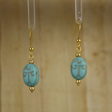 Bamboo Center View - Large Blue Glass Scarab on Gold Plate Earwires (1433)