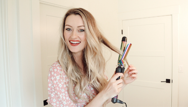 curling hair extensions over the hair