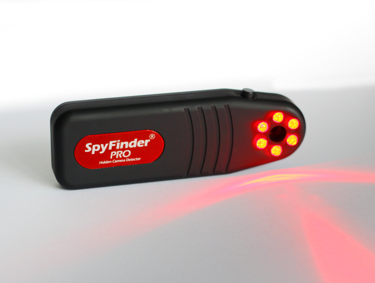 SpyFinder ® PRO Hidden Camera Detector Are Hidden Cameras Watching You Right Now?You wont believe how small hidden cameras are these days. Often no bigger than a pinhole, these tiny spy cameras are concealed inside everyday objects such as clocks, glasses, lamps, picture frames, USB chargers, keychains, desktop fans, outlets, smoke detectors, DVD players, fake water bottles, air fresheners and so much more. These tiny cameras often are built with advanced recording and offsite streaming, allowing unauthorized people to watch and record your activity, and in many cases, using your compromised activity demanding money or else threaten you with releasing the footage to the public.The news is dominated by horrified unsuspecting people getting their privacy destroyed by digital peeping toms who have installed hidden cameras in Airbnb, cruises, hotels, dressing rooms, apartments and many other locations people thought were safe. Until now, unsuspecting people had no way to know if their privacy is being violated until it's too late. Now with SpyFinder® PRO, travelers can feel safe from prying eyes when arriving to new locations.How Does It Work?In Seconds, Youll Know If Youre SecureWhen the power button is pressed on side of unit, and you look through the viewfinder, it activates six special bright-red LED strobe lights designed to bounce off the smallest of camera lenses. The tiny camera lens will appear to blink back at you as a reflection off camera lens itself , instantly giving away its location as you scan the area around you. It doesnt matter if the camera is turned on or off, recording or not...even if its a non-working camera, the blinking effect will clearly show you the presence of a camera lens which is almost impossible to detect with the naked eye. Knowing where the camera is located will allow you to take immediate action to prevent unauthorized recording of activity. In addition, there are 3 LED intensity levels which helps hone in on camera lenses which could be hidden behind different surfac
