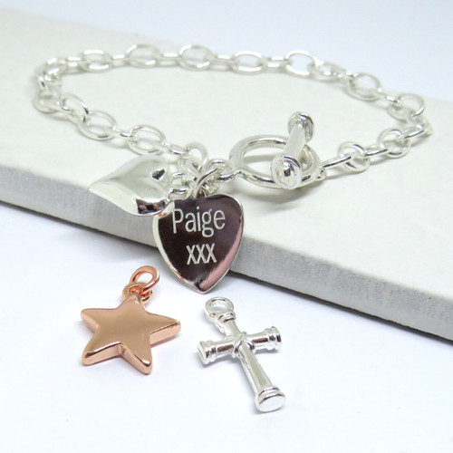 Engraved link bracelet with charm and personalised heart in silver.