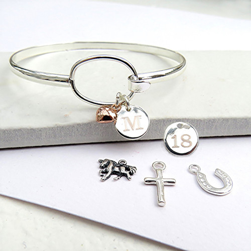 Engraved personalised silver plated bangle comes with a tiny 6mm sterling silver or rose gold plated heart charm, skull,cross,teddy,heart,horseshoe,feather,unicorn,key.