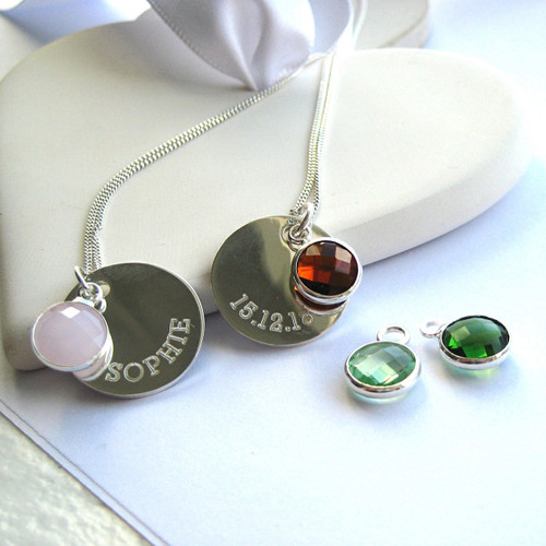 Our border engraved birthstone engraved necklace is made from a fine sterling silver chain & is personalised with your choice of name or words on a sterling silver 15mm round metal disc making this a great gift that is perfect for a young lady or women.