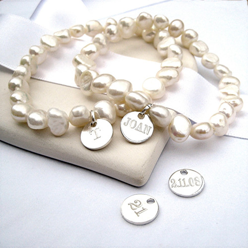 Engraved pearl stacking bracelet a popular present for bridesmaids & weddings  or as a gift for a women or teenage girl on her birthday Christmas, Valentines gift or for Mother's day under £20. Our personalised jewellery is a unique gift for women and girls to receive as each piece is made just for them by our team in the UK Scotland.