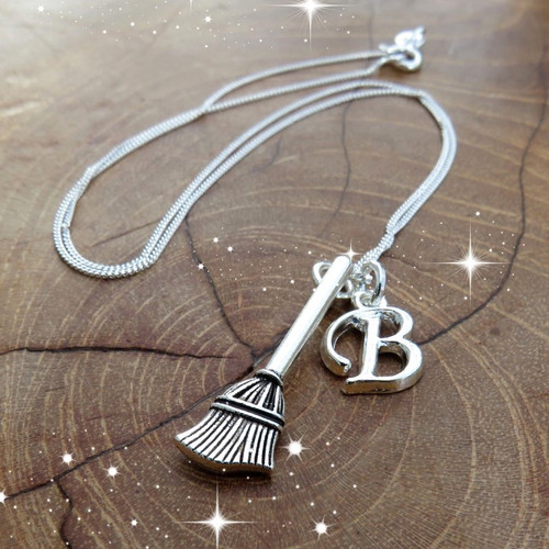 A fun Harry Potter inspired personalised mini-broom charm necklace is made from a fine sterling silver chain & comes with your choice of silver plated initial.