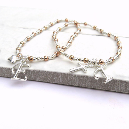 Mini charm stacking bracelet made rose gold & sterling silver plated balls an initial and cute little charm a great gift for a women or teenage girl for their birthday.