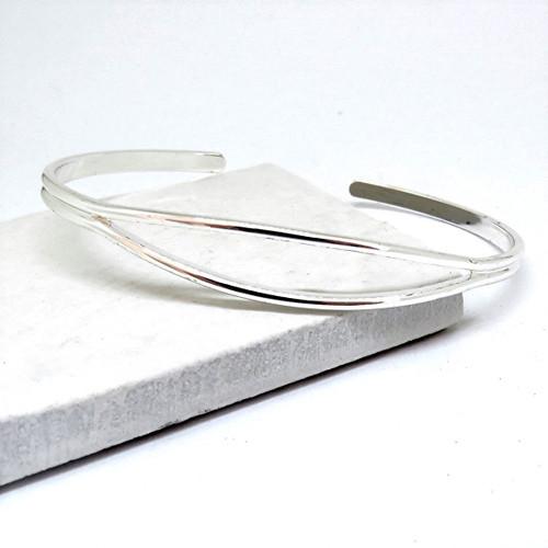Women's silver open cuff bangle plated with sterling silver a unique gift for a woman a keepsake gift for a bridesmaids, for her birthday or Christmas.