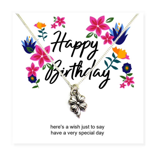 Happy birthday flower necklace on a flower message card. A lovely gifts for a little girl, teenage girl or women on her birthday.