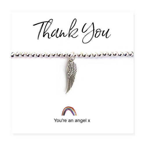 "Angel wing bracelet on a little rainbow message card with the words ""Thank you, You're An Angel x"""