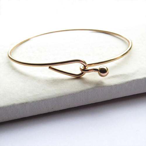 Women's gold hoop cuff bangle plated with sterling silver a unique gift for a woman a keepsake gift for a bridesmaids, for her birthday or Christmas.