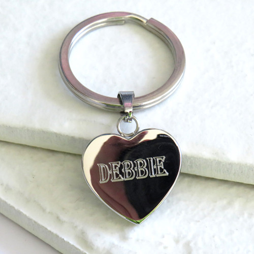 Personalised heart keyring engraved with bold name a unique gift for a mum or dad on Father or Mothers Day or for your gran or grandpa. Trade Gifts dropshipping UK corporate.