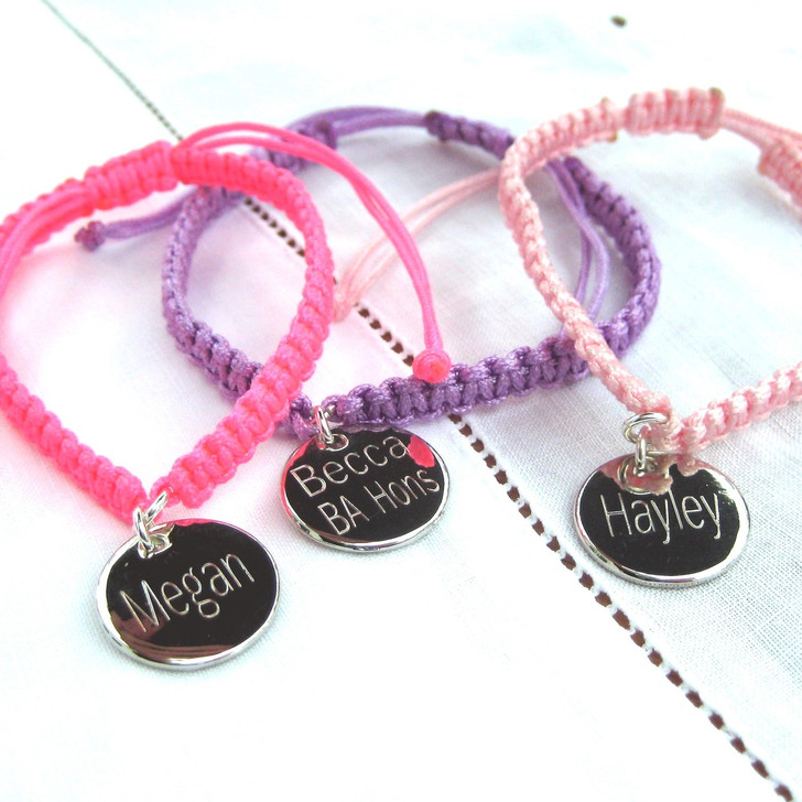 Our dainty braided personalised friendship bracelet is made from nylon cord & comes with an engraved 13mm round metal disc - a very popular with women & teenage girls, the modern design is great for a birthday, Christmas,graduation of even for a well done gift.