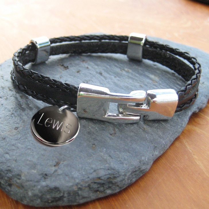 Our personalised multi-strand leather & cord men's bracelets are engraved with your choice of words or numbers on a 14mm shiny round metal disc charm, finished off with a simple robust alloy clasp & finishing. A great gift for a trendy man whether it's his birthday, Fathers day or Christmas or is you feel like being romantic add a special message on valentines day.