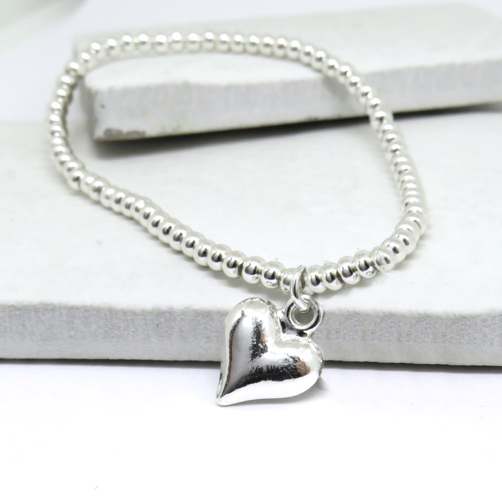 Stretch silver beaded bracelet with a lovely chunky heart on stretch elastic, a unique gift for her birthday Christmas, Valentines gift or for Mother's day. Suitable for girls age 11 to adults.