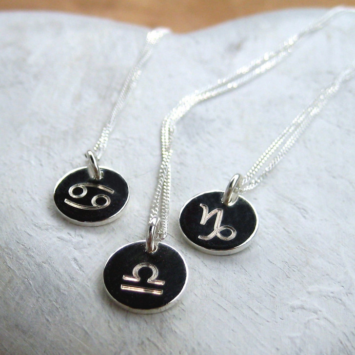 Our zodiac necklace comes with your choice of star sign on a sterling silver fine chain with a 10mm zodiac discs plated with sterling silver. Made just for you - what a lovely gift for a women or a girl for a birthday or special occasion.