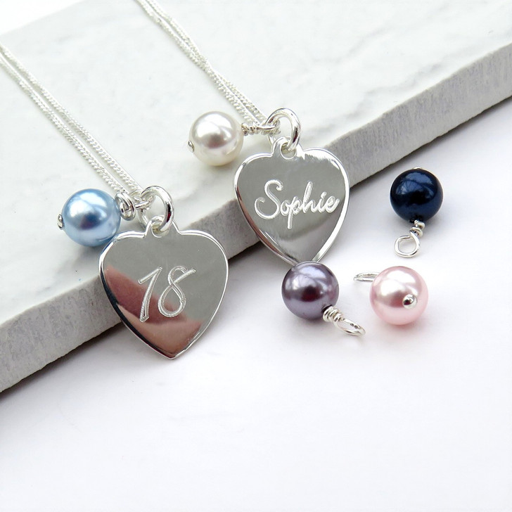 Personalised Swarovski glass pearl necklace with sterling silver chain & has a small sterling silver heart with your choice of script engraving for any occasion.