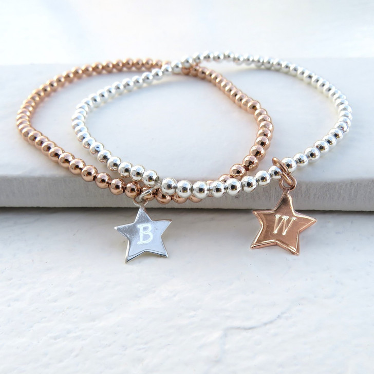 Personalised rose gold plated or silver plated star charm stacking bracelet with plated balls on elastic with a choice of sterling silver or rose gold plated charm.