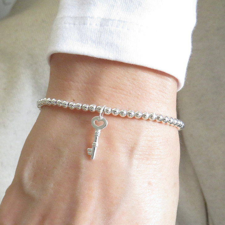 silver stacking ball bracelet with silver key uk