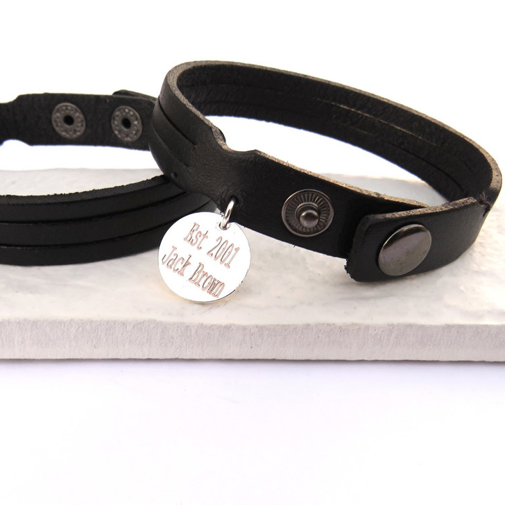 Personalised mens black leather trio bracelet is engraved and finished off with 2 studs to fit either a teenage boy or a man. These are a great gift for a birthday or christmas present.