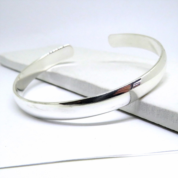 Women's chunky silver bangle a plain design that looks good on its own or with stacking bracelets are a great gift for bridesmaids or for her birthday.