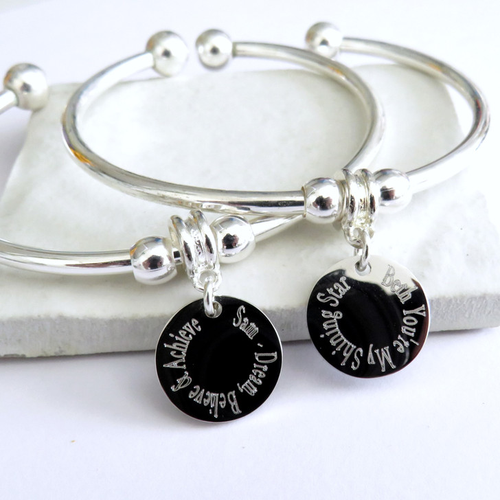 personalised bangle with a round silver plated disc engraved for you an ideal gift for a teenage girls birthday, for a women's Christmas gift.
