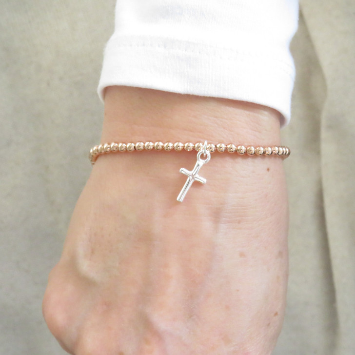Silver cross charm stacking rose gold stretch bracelet a great gift for holy communion, Christening, Baptism, Confirmation or a birthday gift for her under £25.