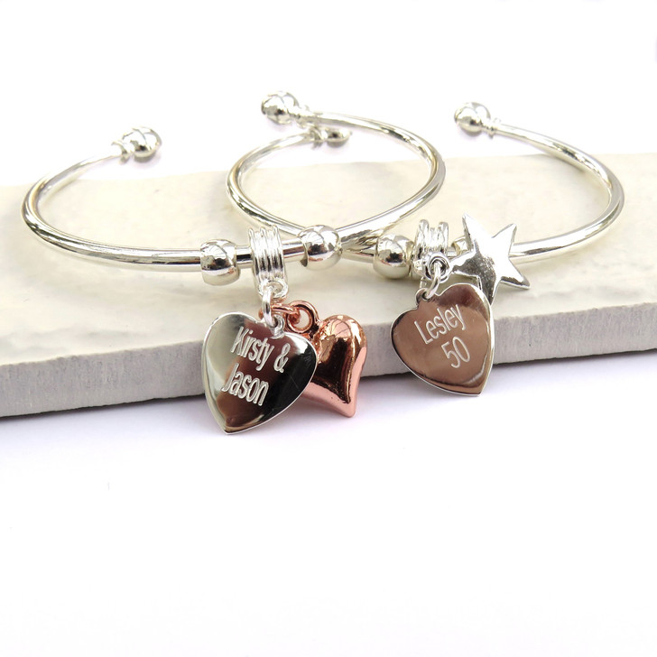 Personalised silver plated bangle with a sterling silver heart charm engraved with you chosen word & a charm of your choice.  A modern design that suits teenage girls & women.
