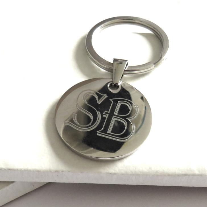 Personalised round silver keyring engraved with your choice of words or special message a unique for a mum or dad on Father or Mothers Day or for your gran or grandpa. Trade Gifts dropshipping UK