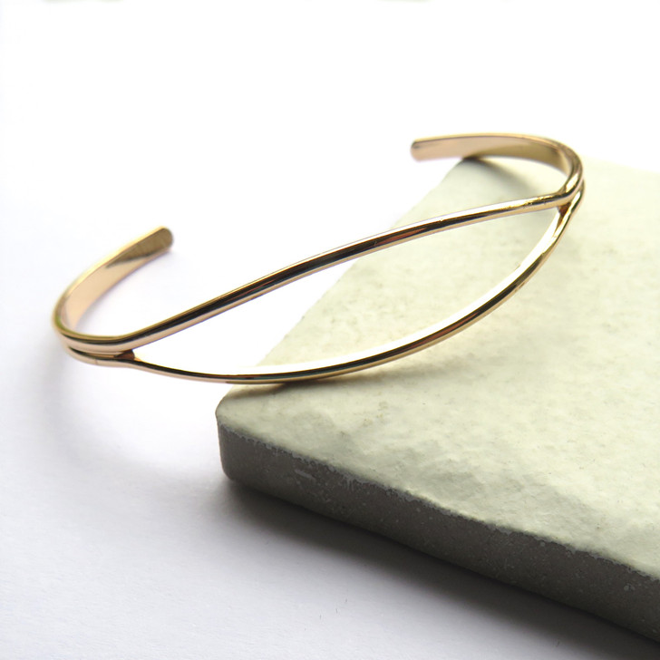 Women's gold open cuff bangle plated with sterling silver a unique gift for a woman a keepsake gift for a bridesmaids, for her birthday or Christmas.