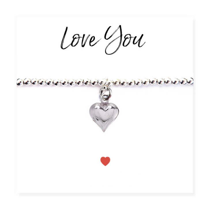 """Silver heart charm stretch beaded bracelet is presented on a message card with the words """"Love You""""  Trade drop shipping UK ayedogifts perfect for Valentines, Mothers day, Thank you, her birthday for your sister, girl friend, Auntie, Mum or Gran."""