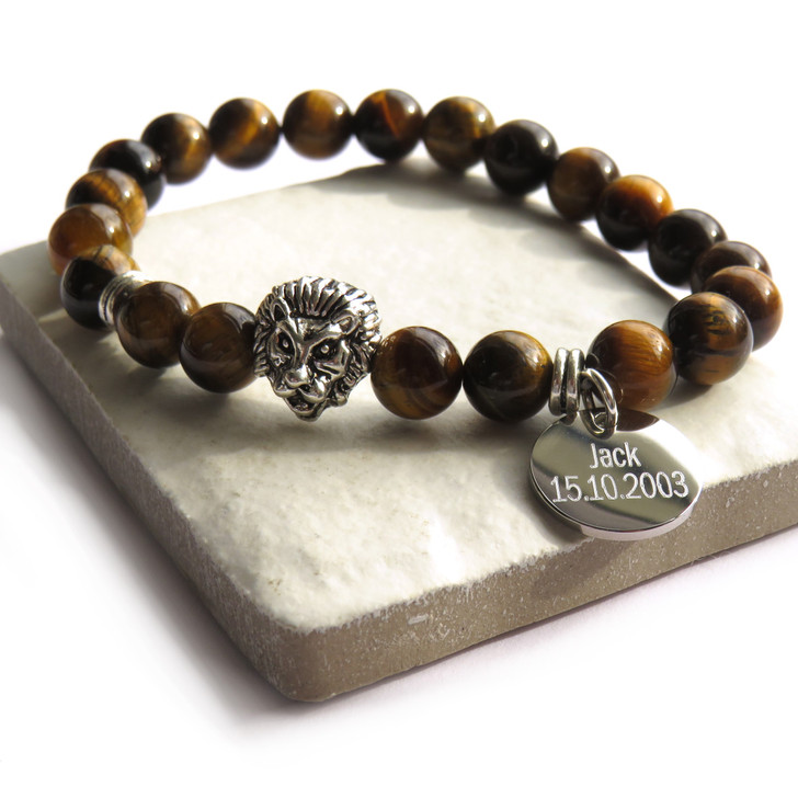 Personalised men's lion head charm bracelet is made from natural tiger eye beads that are polished & silver coloured metal beads on elasticated thread. A great gift for a man or teenage boy whether it's his 16th,18th or 40th birthday, Father's day , Valentines or Christmas. UK supplier drop shipping.