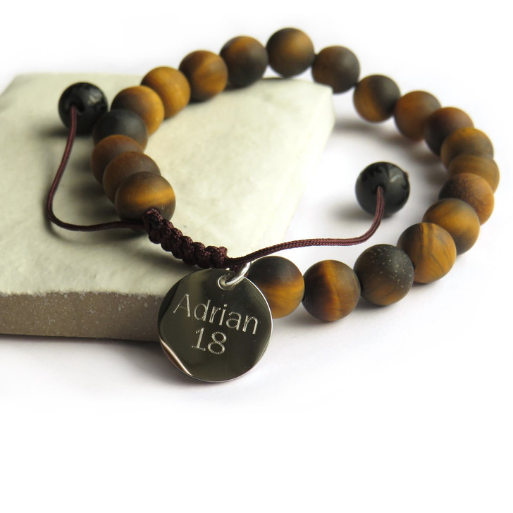 Personalised men's tiger eye bracelet is made from natural beads with a matt finish on a nylon thread that is adjustable so it's suitable for a man or teenage boy. Great for a boy or man whether it's his 16th,18th or 40th birthday, Father's day , Valentines or Christmas or for a new Daddy. Uk dropshipping.