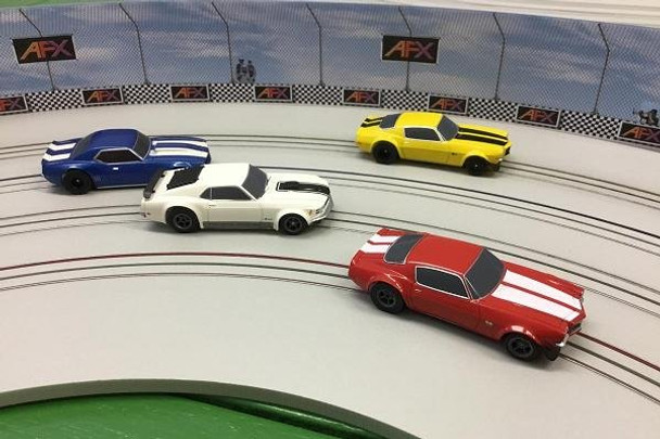 AFX Race Barrier installed on a custom routed HO slot car track