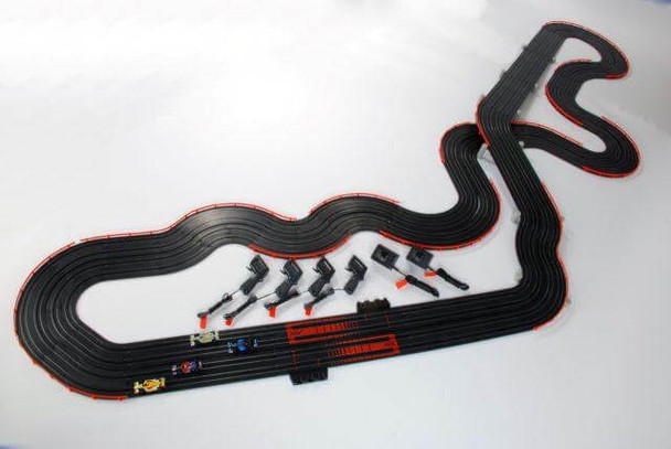 AFX Super International assembled track layout with four Mega-G+ H0 slot cars, four hand controllers and two AFX Tri-Power packs