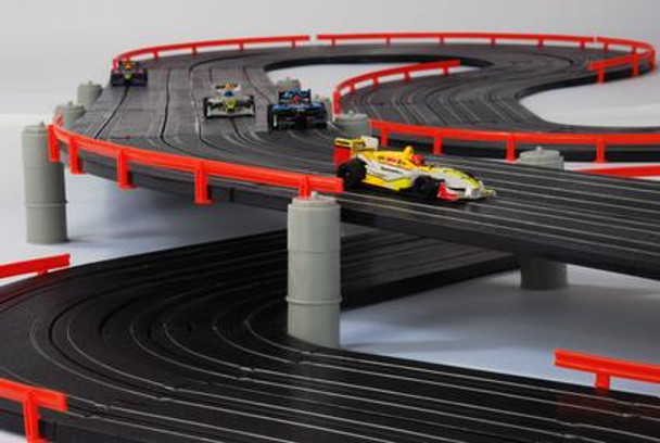 AFX Super International overpass with four Mega-G+ HO slot cars driving on the track