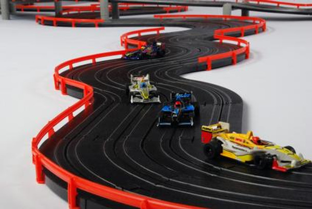 AFX Super International twisty track section with four Mega-G+ slot cars racing on the track