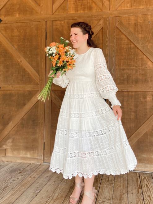Just the Beginning White Smocked Dress