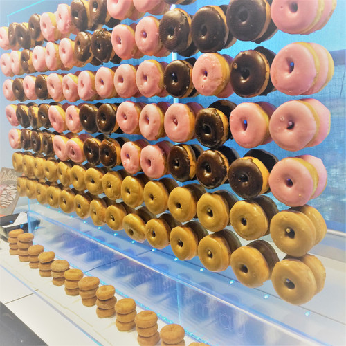 Our Donut Wall is unlike any other, for starters it is illuminated which is perfect for those events when dessert is being served but the lights have already been dimmed. The other great thing is it can serve 200 - 300 guests easily as the donuts can be doubled up giving 228 hanging donuts.
