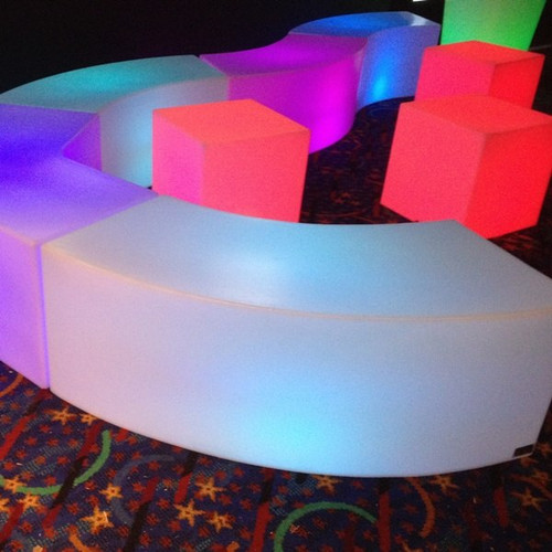 This illuminated curved bench seating offers many design layouts and helps seat 2 or 3 people
