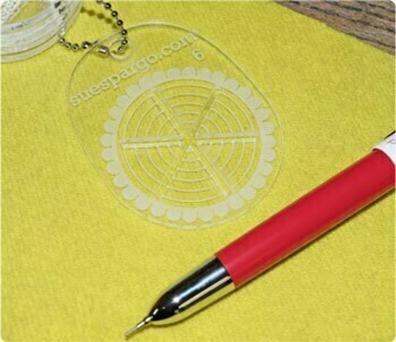 First determine where you'd like your stitch to appear and how many spokes you'd like it to have. Remove the guide from the chain or separate it from the others to place it on your piece.
